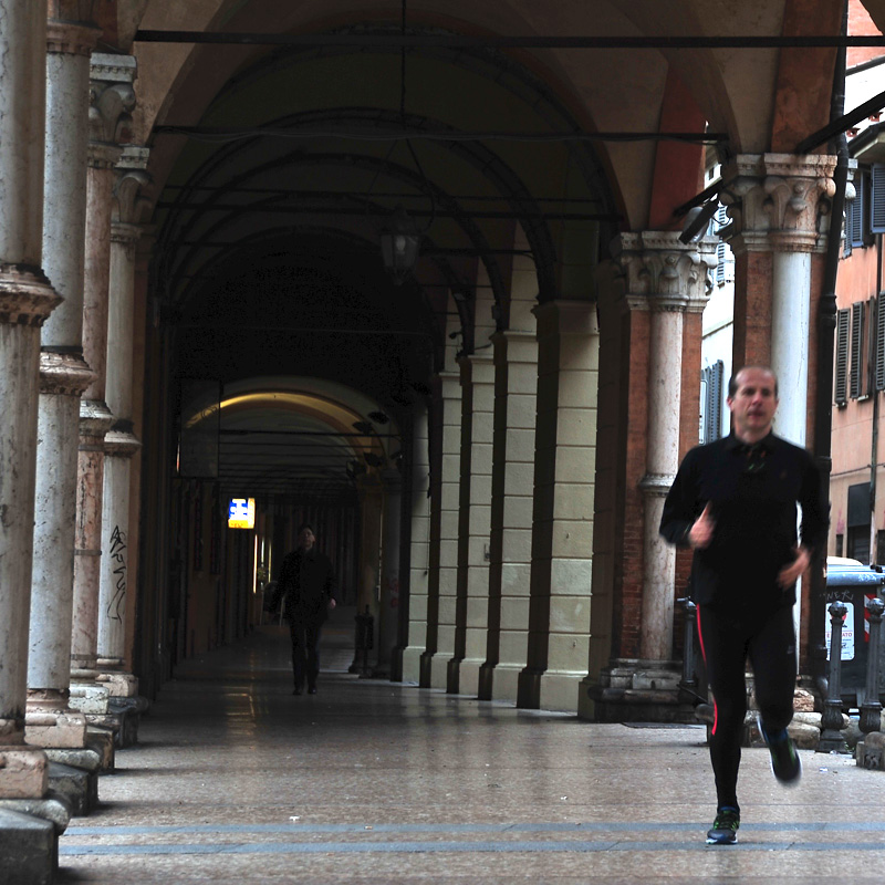 Running in Bologna under porticoes in the main street